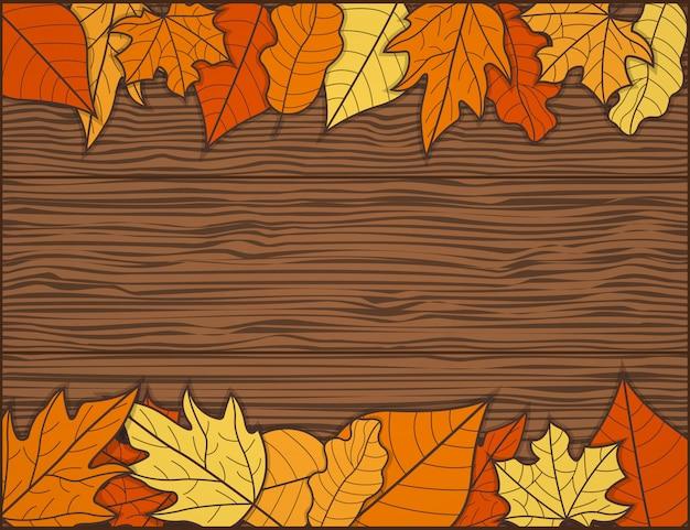Quadro de folha de outono com fundo de mesa de madeira