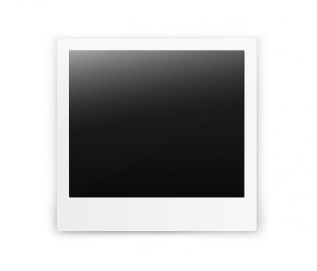 Quadro de foto instantânea em branco vertical realista retro sobre uma mesa