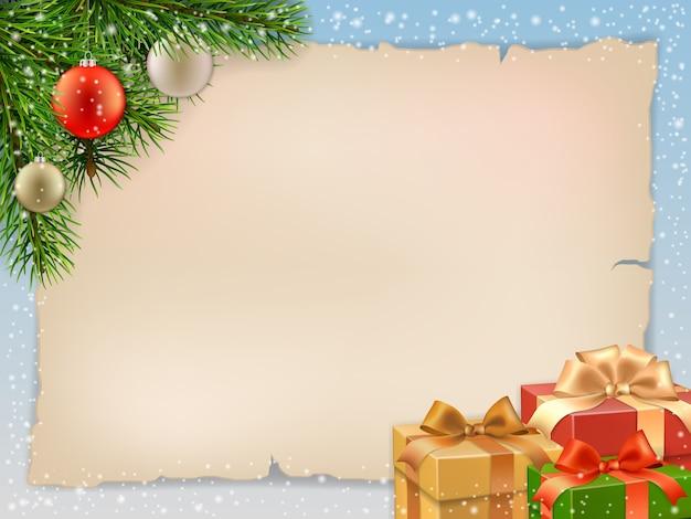 Quadro de natal com galho de pinheiro e caixas de presente.