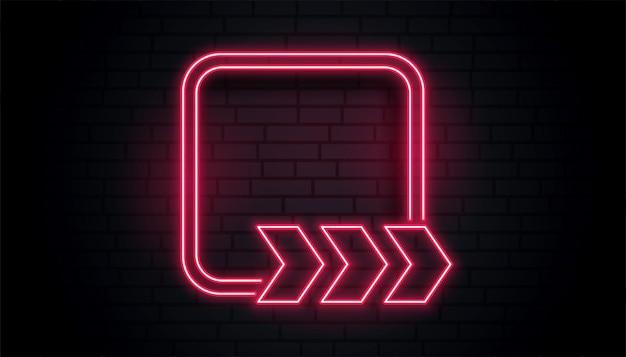 Quadro de néon vermelho com seta de direção