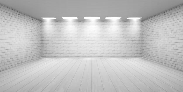 Quarto vazio, com paredes de tijolo branco no estúdio