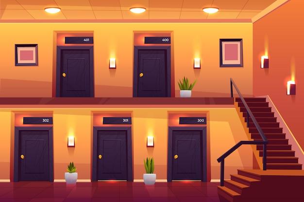 Quartos no corredor do hotel com escadas no segundo andar
