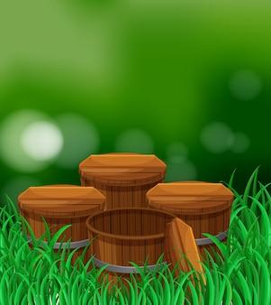 Quatro baldes de madeira no jardim