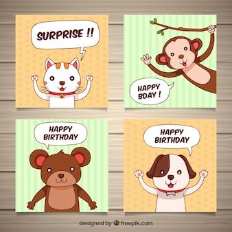 Quatro cartões de aniversário desenhados à mão com animais
