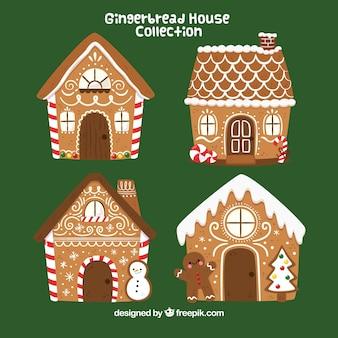 Quatro casas de gengibre desenhadas a mão