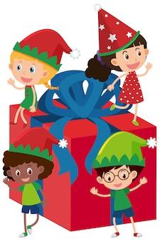 Quatro crianças na caixa de presente vermelha