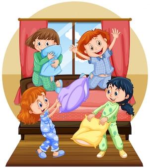 Quatro meninas jogando travesseiro no quarto
