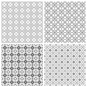 Quatro padrões de azulejos monocromáticos sem costura