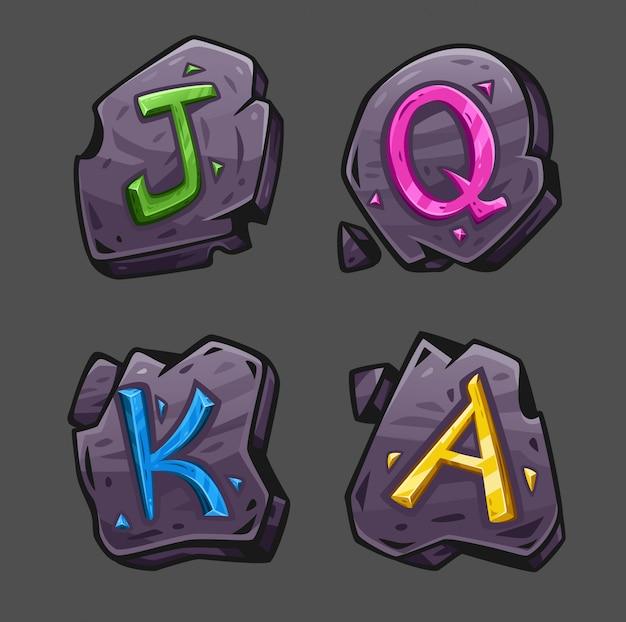 Quatro pedras com cristais coloridos em forma de letras jqka