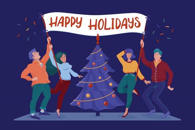 Quatro pessoas felizes, sorridentes, homens e mulheres, segurando o cartaz com boas festas cumprimentando o texto perto da árvore de natal