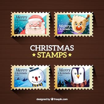 Quatro selos de natal com personagens de natal