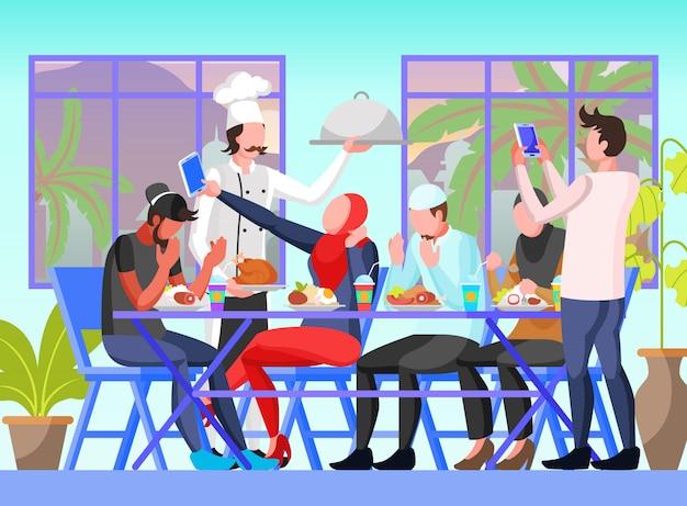 Quebrando rápido com colegas, amigos e familiares em restaurante