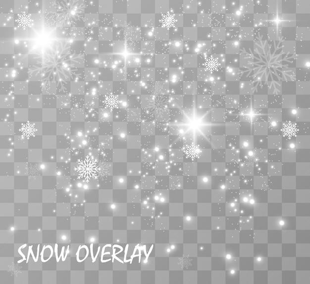 Queda de neve. muita neve em um fundo transparente. fundo de inverno natal. flocos de neve caindo do céu.