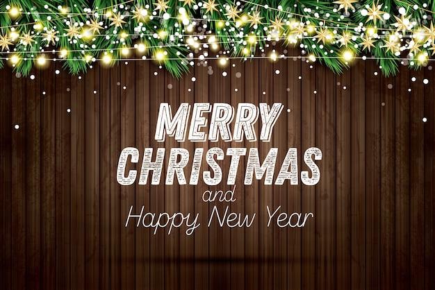 Ramo de abeto com luzes de néon e flocos de neve em fundo de madeira. feliz natal e feliz ano novo.