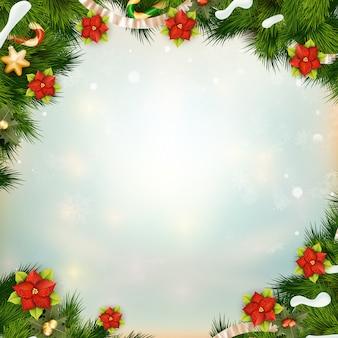 Ramos de pinheiro verde brilhante como quadro com flor de poinsétia.