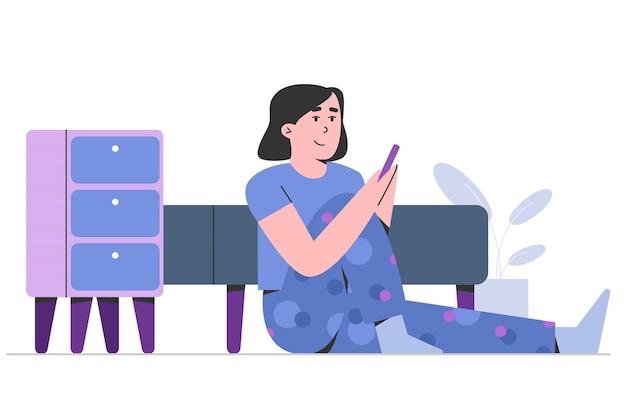 Rapariga com telemóvel no quarto