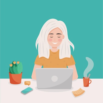 Rapariga loira trabalhando no laptop