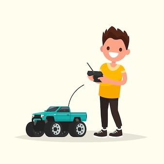 Rapaz com um carro controlado por rádio.