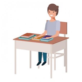 Rapaz jovem estudante sentado na mesa da escola