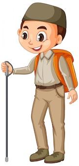 Rapaz muçulmano com bastão de caminhada