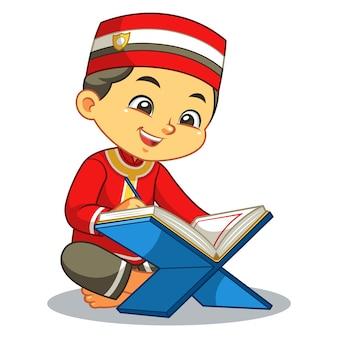 Rapaz muçulmano lendo o alcorão