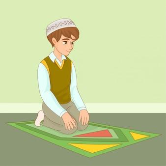 Rapaz muçulmano rezando no ramadã