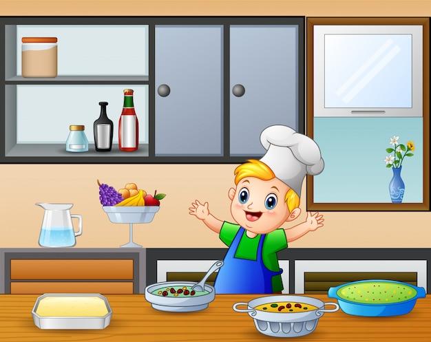 Rapaz pequeno bonito dos desenhos animados no avental e chapéu de chef