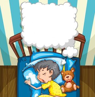 Rapaz pequeno em pijama amarelo dormindo