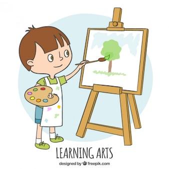 Rapaz pequeno que aprende como pintar