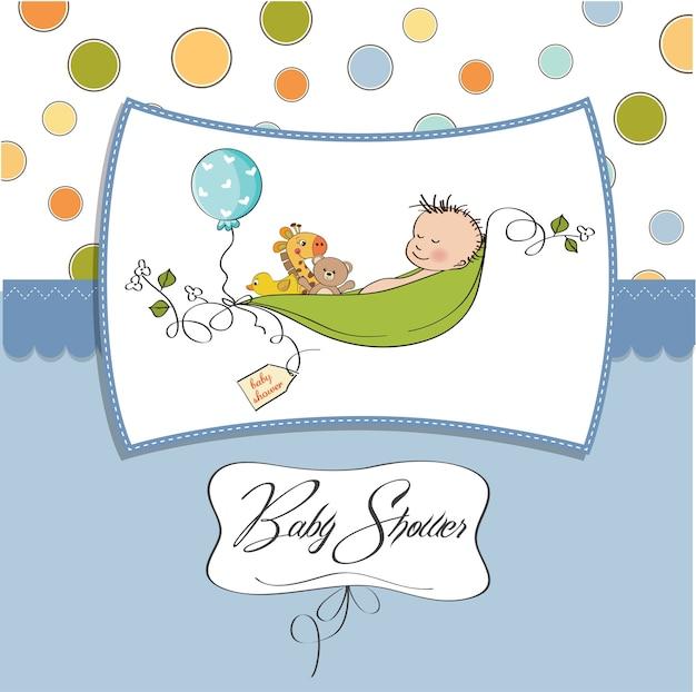 Rapaz pequeno que dorme em uma ervilha sido, cartão do anúncio do bebê
