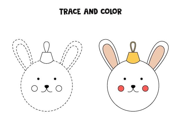 Rastrear e colorir bugiganga de natal dos desenhos animados. planilha para crianças.