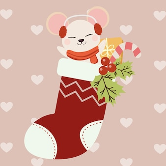 Rato bonitinho sentado em uma meia de natal vermelha
