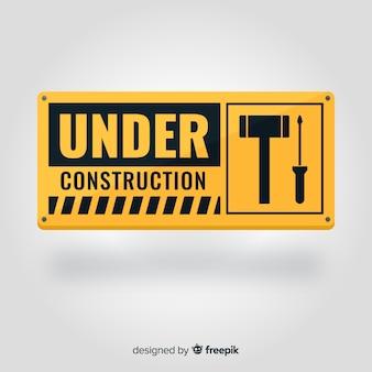 Realista em fundo de sinal de construção