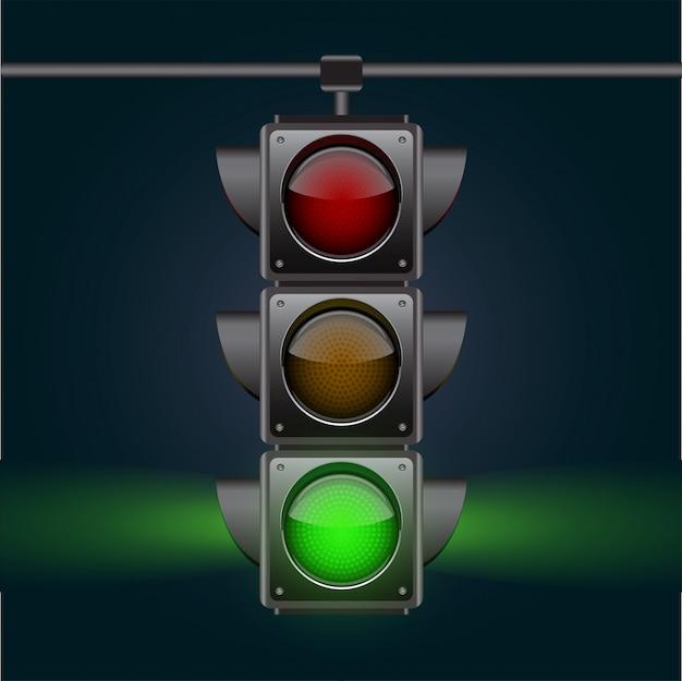 Realistas semáforos com lâmpada verde, pendurado no céu noturno.