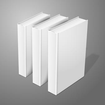 Realistas três em pé branco em branco livros de capa dura. isolado no fundo para design e branding.