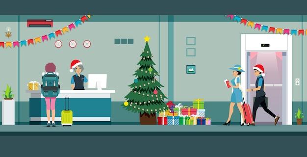 Recepcionista do cliente decorando o saguão de natal