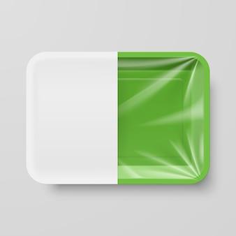 Recipiente de comida de plástico verde vazio com etiqueta branca