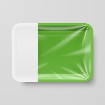 Recipiente de comida de plástico verde vazio com etiqueta vazia em cinza