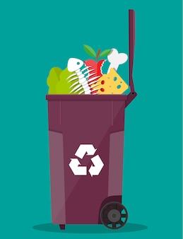 Recipiente de lata de lixo cheio de junk food