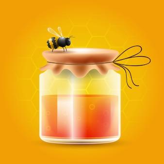 Recipiente de mel com abelha em cima do recipiente