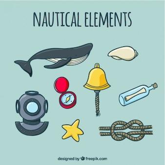 Recolha de mão desenhada baleias e elemento náutico