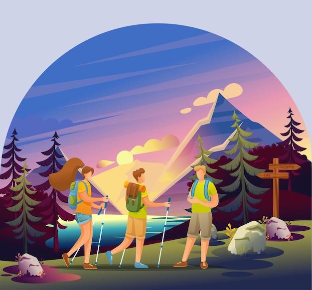 Recreação ativa na floresta. jovens caminham em grupo na floresta
