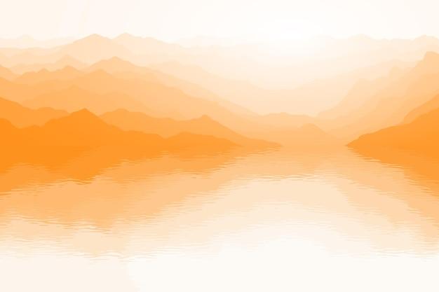 Reflexo pitoresco de montanhas no lago