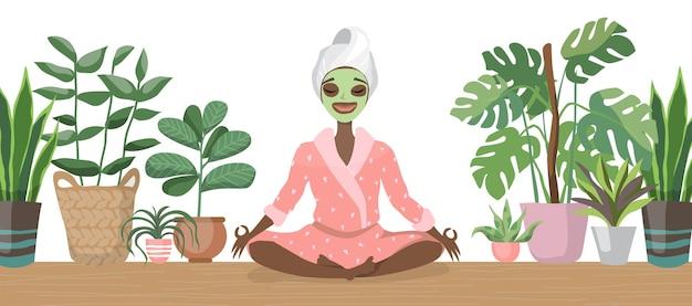 Relaxe a bela jovem negra afro-americana com máscara facial. cuidados com a pele e conceito de tratamento, spa, beleza natural e cosmetologia. relaxando em casa