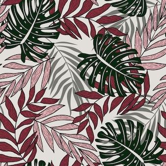 Resumo padrão sem emenda com folhas tropicais coloridas e plantas sobre um fundo delicado