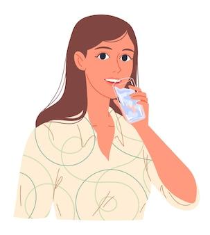 Retrato de uma jovem mulher bebendo água em um copo.