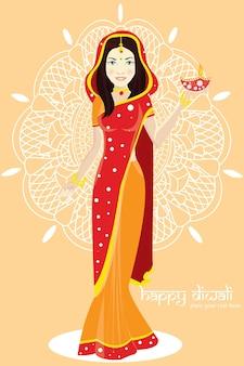 Retrato de uma mulher segurando um tradicional diwali tali, oferenda religiosa e sorrindo. mulher com lindo sari e ofertas.