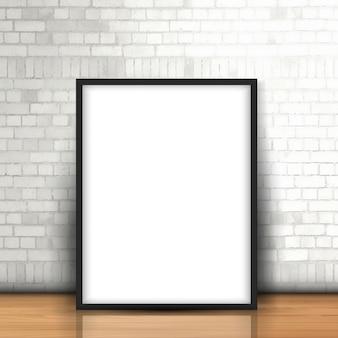 Retrato em branco encostado a uma parede de tijolo branca