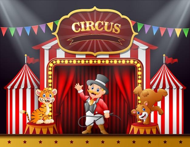 Ringmaster dos desenhos animados e muitos animais desempenho no palco