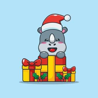 Rinoceronte fofo e caixa de presente de natal ilustração fofa dos desenhos animados de natal